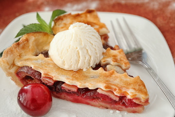 Delicious piece of cherry pie with ice cream on plate, closeup