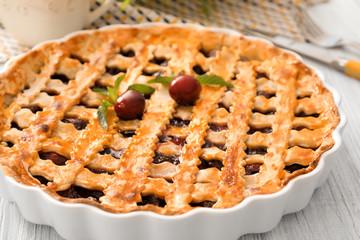 Delicious cherry pie on kitchen table