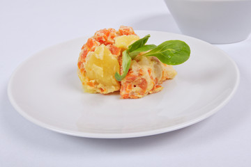 Cream potatoes with vegetables on a white