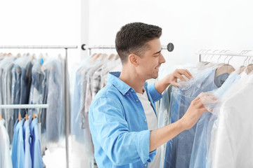 Employee working at dry-cleaner's