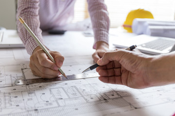 Blueprint photos royalty free images graphics vectors videos architect working on blueprint with architect equipments on desk at workplace malvernweather Gallery