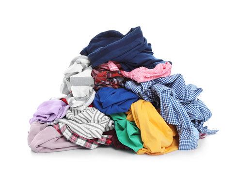 Pile of dirty clothes on white background