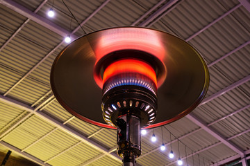 Gas terrace heater or patio heater under high roof