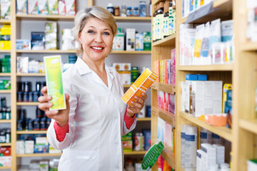 Mature female seller suggesting useful skin care products
