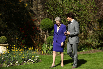 Britain's Prime Minister Theresa May speaks with Canada's Prime Minister Justin Trudeau in the gardens of 10 Downing Street in London