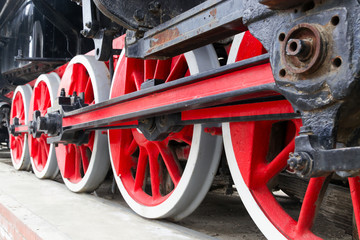 Iron red wheels of the old train