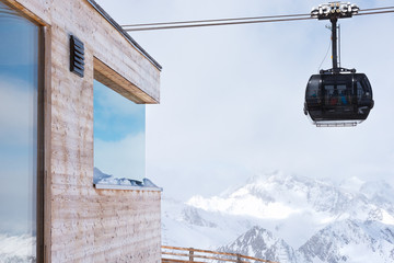 Cable car at a ski resort. The movement of the black cabin