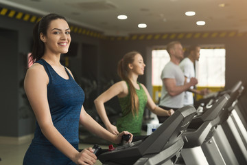 Fitness people training in gym on treadmills