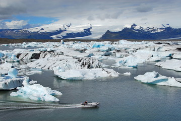 Iceland. Motor boat among the icebergs in the glacial lagoon