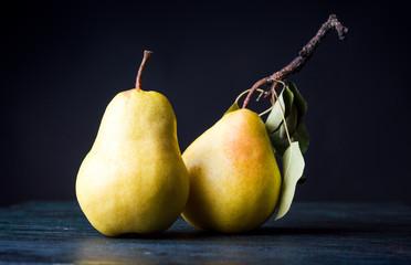 Pears on dark wooden background