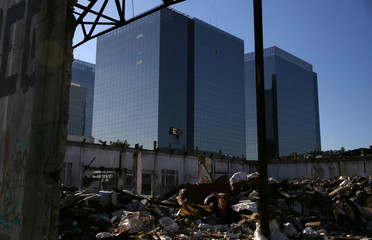 Modern buildings are seen next to an abandoned warehouse in the port area in Rio de Janeiro