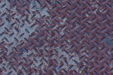 Urban diamond plate closeup texture background.