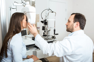 ophthalmologist and a patient, during a vision test, while in a medical clinic