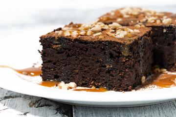 dessert - pieces of chocolate brownies with caramel sauce, closeup