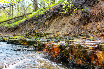Limestone outcrops on a creek in a ravine