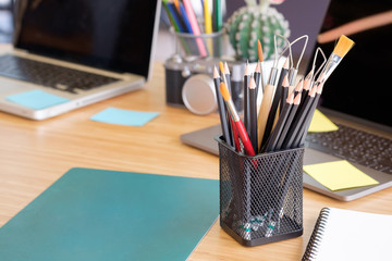 pencil in jar on workspace table in office.