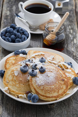 homemade pancakes with blueberries and powdered sugar, vertical