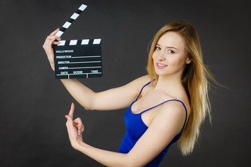 Woman holding professional film slate