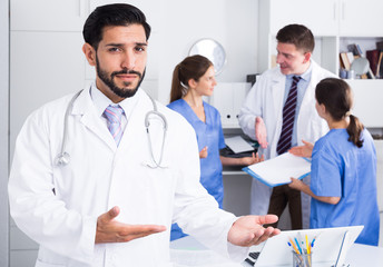 Male doctor meeting patient in medical office