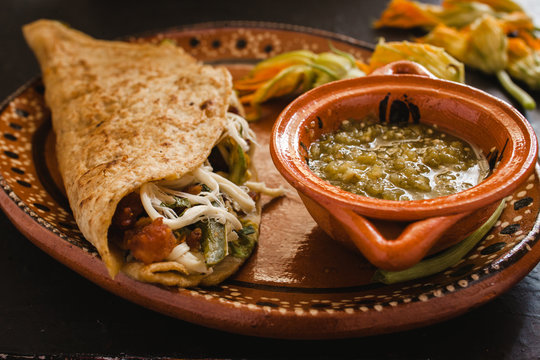 mexican quesadilla with squash blossom, cheese and sauce in mexico city