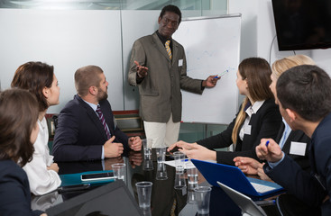 man giving presentation to colleagues at international business meeting
