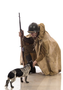 A soldier of the Russian army stroking a dog