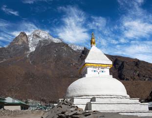 Mount Khumbila and buddhist white stupa near Khumjung village, Nepal Himalayas
