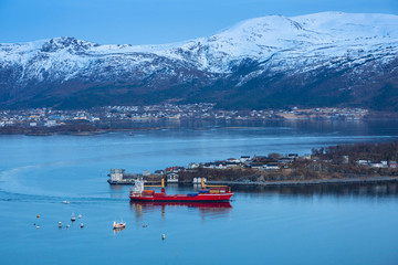 Coastline of Alesund with snowy mountains, Norway