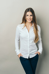 Young smiling woman wearing white shirt