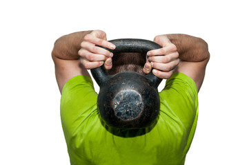 Man workout with kettlebell in the gym, real people workout no posing