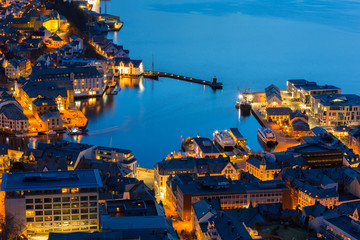 Beautiful Alesund port town at night in Norway