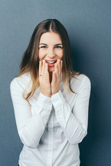 Overjoyed young woman with a beaming smile