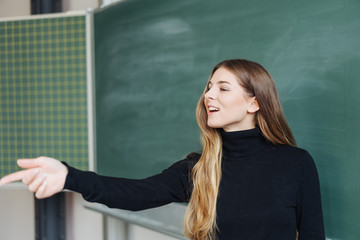 Young woman teacher doing a class lecture