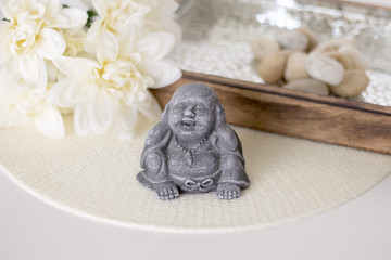 Small Buddha, badth, spa on white background