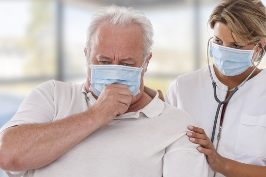doctor examining lung of patient wearing mask for protection flu virus