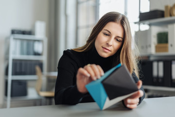 Pensive young woman examining a 3d model