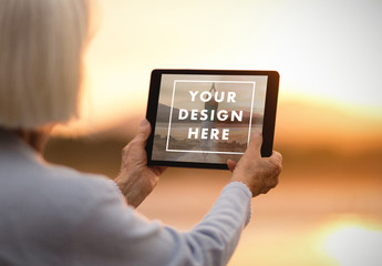 Woman Holding Tablet at Sunset Mockup