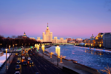 Sunset over famous landmarks - Kotelnicheskaya Embankment Building in Moscow, Russia