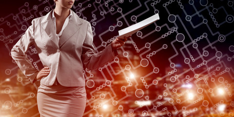 Close of businesswoman against night cityscape background and technology concept