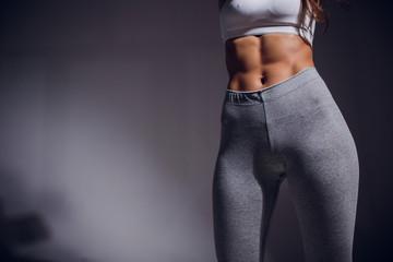 Figure sports girl on black background