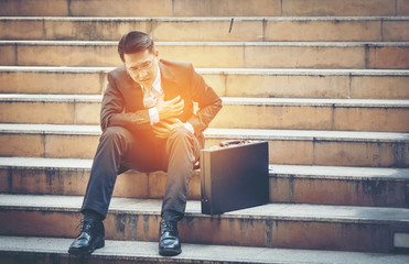 Businessman hurt heart on the stairs.