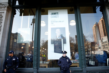 NYPD officers stand outside the Barnes & Noble bookstore where former FBI director Comey will have a book signing in Manhattan