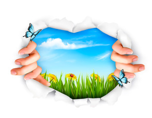 Wall Mural - Nature background with hands ripping a paper. Vector