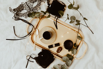 Flat lay woman lingerie on gold tray. Elegant items