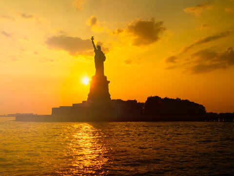 The Statue of Liberty in New York City at sunset