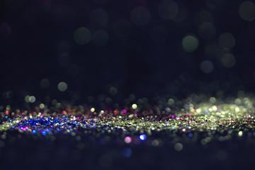 Bokeh glitter fly and lights on black