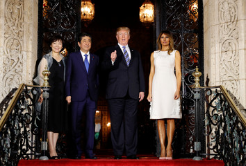 U.S. President Trump  and first lady Melania greet Japan's PM Abe and wife for dinner in Palm Beach