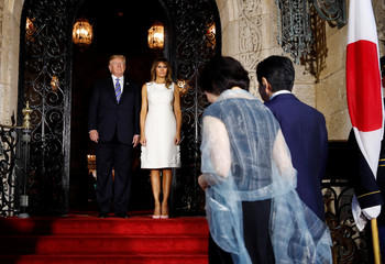 U.S. President Trump and first lady Melania greet Japan's PM Abe and wife as they arrive for dinner in Palm Beach