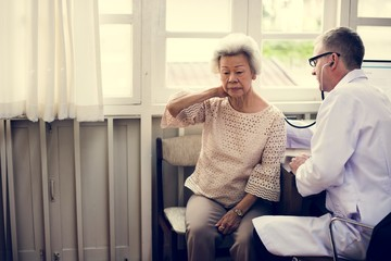 An elderly patient meeting doctor at the hospital