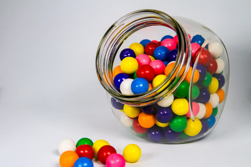 Colorful Bubble Gum Ball in a Clear Glass Cannister